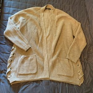 tan cardigan with silver detailing on sides